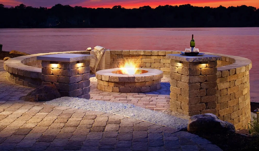 classic custom fire pit patio with circular wall